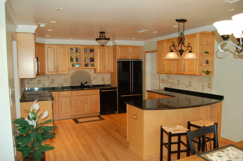 kitchen on Maple Kitchen Cabinets With Black Granite Countertops  id=27021